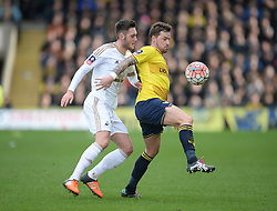Chris Maguire of Oxford United shields the ball from Matt Grimes of Swansea City - Mandatory byline: Alex James/JMP - 10/01/2016 - FOOTBALL - Kassam Stadium - Oxford, England - Oxford United v Swansea City - FA Cup Third Round