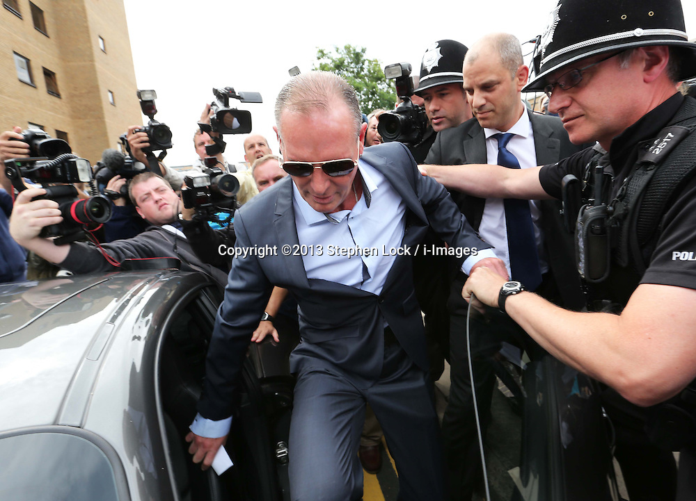 Former England footballer Paul Gascoigne leaving Stevenage Magistrates Court in Hertfordshire after being found guilty of  assault,  Monday, 5th August 2013<br /> Picture by Stephen Lock / i-Images