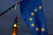 "An EU flag is waved in front of the British parliament as the British government debated US President Donald Trump's state visit to the UK, thousands of protesters gathered in large numbers against the trip which would potentially cost millions of Pounds in security alone. The visit comes after two online petitions received more than the 100,000 signatures required for such a debate to be considered in Parliament. A petition against the state visit got 1.85m signatures, while one supporting it got 311,000. Campaigners protested against the ""hatred, racism and division that Donald Trump is trying to create"". Prime Minister Theresa May announced the state visit during her visit to Washington in January."