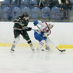 KINGSTON, ON - MAR 9,  2017: Ontario Junior Hockey League, playoff game between the Cobourg Cougars and Kingston Voyageurs, Reid Russell #28 of the Kingston Voyageurs fights to control the puck during the 2nd period.<br /> (Photo by Ian Dixon/ OJHL Images)