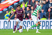 Demetri Mitchell (#11)  of Heart of Midlothian runs at Mikael Lustig (#23) of Celtic FC during the Betfred League Cup semi-final match between Heart of Midlothian FC and Celtic FC at the BT Murrayfield Stadium, Edinburgh, Scotland on 28 October 2018.