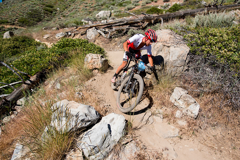 Howard Grotts weaves through rocks and brush on the Ash to Kings trail.