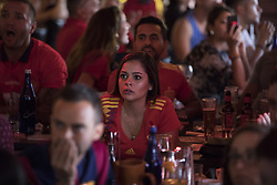 July 1, 2018 - Miami Beach, FL, USA - Michele Alamo, 30, watches a soccer match at Tapas and Tintos, a restaurant in Miami Beach, Fla. where fans gathered to watch Spain take on Russia during the 2018 FIFA World Cup Round of 16 knockout stage on Sunday, July 1, 2018. After the score being tied 1-1 at the end of extra time, Russia won, 4 penalty kicks to 3. (Credit Image: © Ellis Rua/TNS via ZUMA Wire)