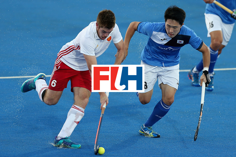 LONDON, ENGLAND - JUNE 20:  Henry Weir of England and Jinkang Rim of South Korea battle for the ball during the Pool A match between England and South Korea on day six of the Hero Hockey World League Semi-Final at Lee Valley Hockey and Tennis Centre on June 20, 2017 in London, England.  (Photo by Alex Morton/Getty Images)