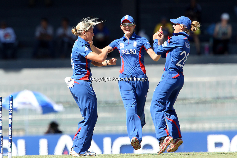 Katherine Brunt celebrates the wicket of Suzie Bates with Danielle Wyatt during the ICC Women's World Twenty20 Semi final match between England and New Zealand held at the Premadasa Stadium in Colombo, Sri Lanka on the 4th October  2012<br /> <br /> Photo by Ron Gaunt/SPORTZPICS/PHOTOSPORT