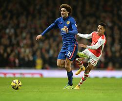 Arsenal's Alexis Sanchez closes down Manchester United's Marouane Fellaini - Photo mandatory by-line: Alex James/JMP - Mobile: 07966 386802 - 22/11/2014 - Sport - Football - London - Emirates Stadium - Arsenal v Manchester United - Barclays Premier League