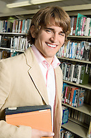 Smiling Young Man in Library