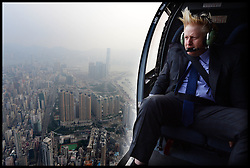 London Mayor Boris Johnson takes a helicopter ride over Hong Kong as he arrive's in the City on Day 5 of his trade mission to China as part of his  6 day visit to China. Thursday, 17th October 2013. Picture by Andrew Parsons / i-Images/ POOL