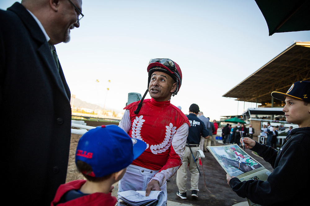 December 26, 2015: Jockey, Mike Smith signs autographs after winning the La Brea Stakes at Santa Anita Park, Arcadia CA. Evers/ESW/CSM