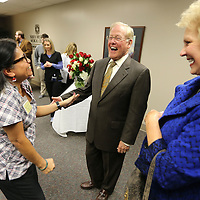 Dr. Ed Hill, center, stands with his wife, Jean, right, as he get a visits friend Maria Summer, a Nurse Care Manager at the North Mississippi Medical Center, during Hill's retirement reception Friday afternoon.