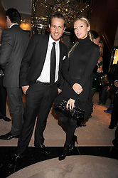 PETRA ECCLESTONE and JAMES STUNT at a party to celebrate the launch of a collection of jewellery by Tamara Ecclestoen for jewellers Moussaieff held at their store in New Bond Street, London on 9th December 2008.