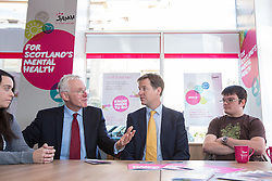 © Licensed to London News Pictures . 07/10/2014 . Glasgow , UK . EMBARGOED UNTIL 00:01 WEDNESDAY 08/10/2014 . Deputy Prime Minister Nick Clegg (2nd from right) visits the Scottish Association for Mental Health with Health Minister Norman Lamb (2nd from left) to meet with staff and service users and discuss mental health issues . The Liberal Democrat Party Conference 2014 at the Scottish Exhibition and Conference Centre in Glasgow . Photo credit : Joel Goodman/LNP