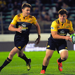 Beauden Barrett (left) and Ricky Riccatelli during the Super Rugby match between the Hurricanes and Force at CET Stadium, Palmerston North, New Zealand on Friday, 18 March 2016. Photo: Dave Lintott / lintottphoto.co.nz