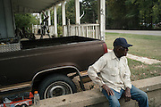 PANOLA, AL – OCTOBER 9, 2015: Leroy James, 71, sits outside his home on Highway 34. Due to state budget cuts, Alabama announced the closure of 31 of its driver's license offices in mostly rural sections of the state, where poverty is high and transportation is notoriously difficult. Critics argue the closures are an attempt to limit accessibility to photo IDs – which are now required for voting – but state officials insist that the closings have no effect on access to photo ID. CREDIT: Bob Miller for The New York Times.