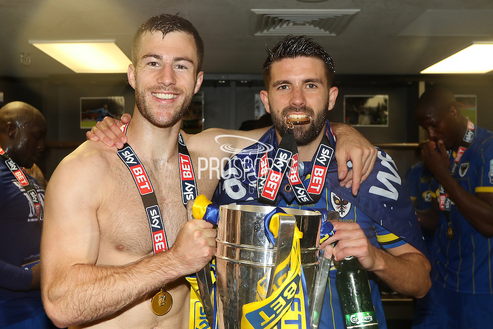 Paul Robinson defender for AFC Wimbledon (6),George Francomb midfielder for AFC Wimbledon (7)  celebrate AFC Wimbledon winning promotion to league 1after the Sky Bet League 2 play off final match between AFC Wimbledon and Plymouth Argyle at Wembley Stadium, London, England on 30 May 2016. Photo by Stuart Butcher.