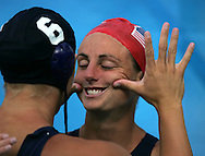 8/26/04 --Al Diaz/Miami Herald/KRT--Athens, Greece--Australia vs USA for the Bronze Medal in Women's Waterpolo at the Olympic Aquatic Centre during the Athen's 2004 Olympic Games. Here Jacqueline Frank is cheered up by teammate Natalie Golda after USA defeats Australia 6-5. USA was favored to win the Gold.