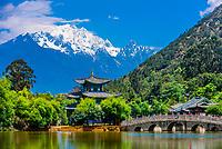 The idyllic Black Dragon Pool with the  18,360 foot Jade Dragon Snow Mountain behind, Lijiang, Yunnan Province, China.
