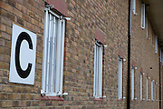 Outside view of the cell windows  of C wing. HMP Send, closed female prison. Ripley, Surrey.