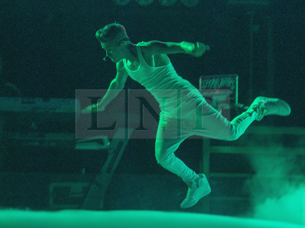 """© Licensed to London News Pictures . FILE PICTURE DATED 21/02/2013 of Canadian pop star JUSTIN BIEBER leaping across the stage at the Manchester Arena , UK , on the opening night of his UK """" Believe """" tour , as a spokeswoman last night (7th March) reported Bieber had to take an unscheduled break during a show at the O2 Arena last night (7th March). Bieber was said to have fainted and had to be treated by doctors with oxygen before returning to the stage . Photo credit : Joel Goodman/LNP"""