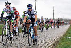 Lotta Lepistö and Lauren Kitchen upfront as the peloton bounce across the cobbles - Pajot Hills Classic 2016, a 122km road race starting and finishing in Gooik, on March 30th, 2016 in Vlaams Brabant, Belgium.