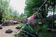 Girl swings on rope swing in risk averse playground called The Land on Plas Madoc Estate, Ruabon, Wrexham, Wales. <br /> <br /> From the chapter entitled 'Playing with Fire' from the book 'Risk Wise: Nine Everyday Adventures' by Polly Morland (Allianz, The School of Life, Profile Books, 2015).