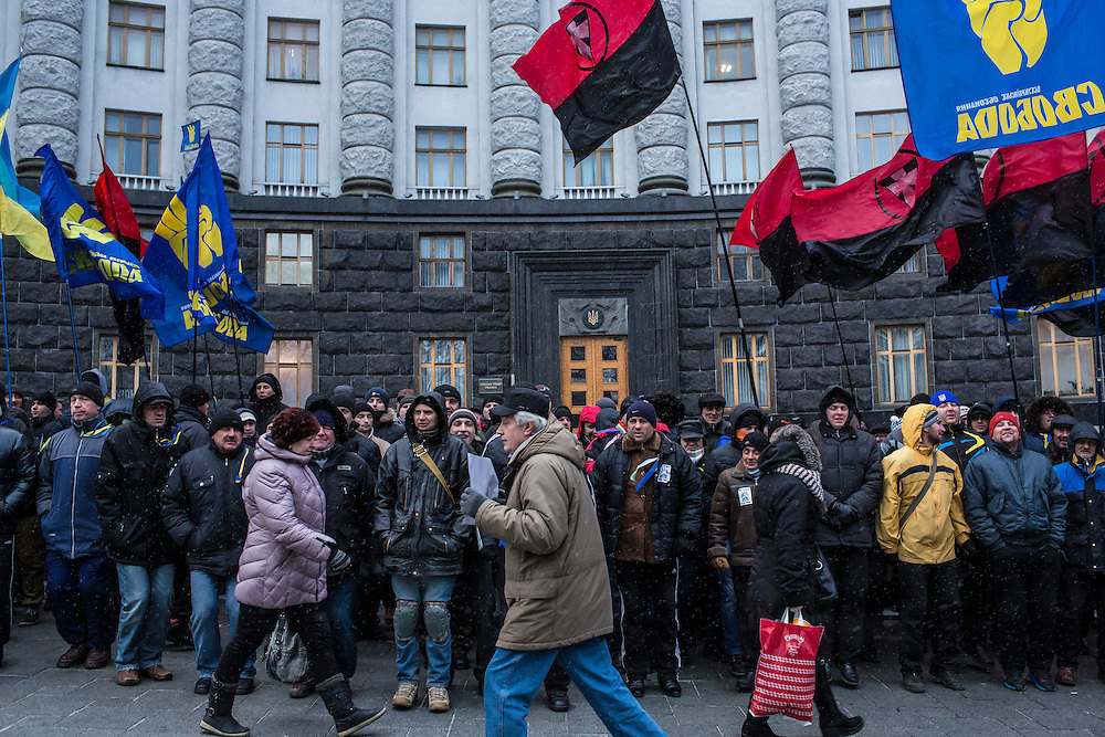 KIEV, UKRAINE - DECEMBER 5: Anti-government protesters hold a rally to block access to the Cabinet of Ministers building on December 5, 2013 in Kiev, Ukraine. Thousands of people have been protesting against the government since a decision by Ukrainian president Viktor Yanukovych to suspend a trade and partnership agreement with the European Union in favor of incentives from Russia. (Photo by Brendan Hoffman/Getty Images) *** Local Caption ***