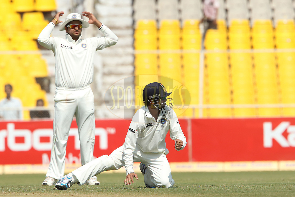 Pragyan Ojha of India and Gautam Gumbhir of India during day 3 of the first test match between India and New Zealand  held at the Sardar Patel Gujarat Stadium in Ahmedabad on the 6th November 2010..Photo by Ron Gaunt/BCCI/SPORTZPICS