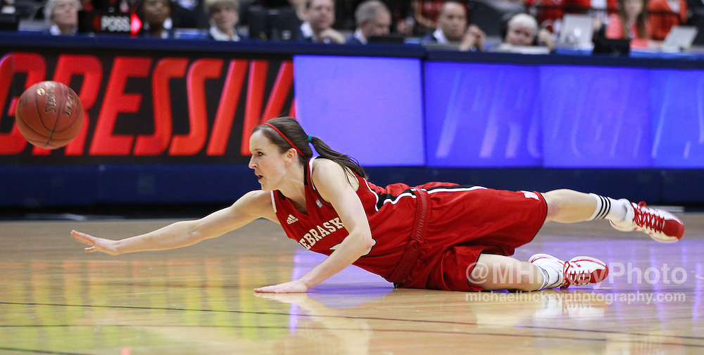 March 04, 2012; Indianapolis, IN, USA; Nebraska Cornhuskers guard Kaitlyn Burke (5) loses control of the ball against the Purdue Boilermakers during the finals of the 2012 Big Ten Tournament at Bankers Life Fieldhouse.  Mandatory credit: Michael Hickey-US PRESSWIRE
