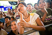02 JULY 2006 - PHNOM PENH, CAMBODIA: Boxing fans cheer for their boxer during a traditional Khmer boxing match in Phnom Penh, Cambodia. Khmer boxing is the same sport as Muay Thai (traditional Thai kick boxing) but because off animosity between Thailand and Cambodia it is called Khmer Boxing in Cambodia. The Cambodians claim to have invented the sport, which is also practiced in Laos and Burma. Photo by Jack Kurtz