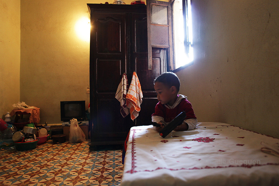 Mohammed, 2 years old, plays in the kitchen /salon/ dining area of the 12 square meter room where he lives with his mum Saida, single mother of 32 years old in Marrakech district Daoudiat - 4 May 2013
