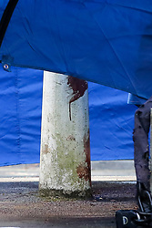 © Licensed to London News Pictures. 02/05/2019. London, UK. Blood stains on a bollard within the police tent on Somerford Grove in Hackney Downs in north London where a 15 years old was stabbed and pronounced dead at the scene at 9.49 pm on Wednesday 1 May 2019. Photo credit: Dinendra Haria/LNP