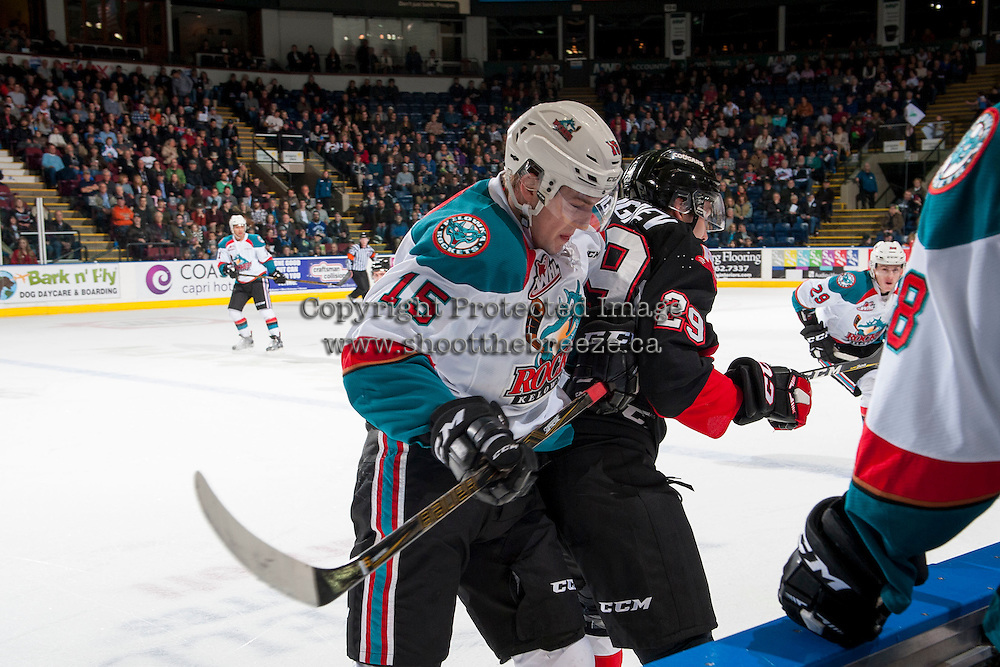 KELOWNA, CANADA - FEBRUARY 18: Tomas Soustal #15 of the Kelowna Rockets checks Nikita Popugaev #29 of the Prince George Cougars in front of the home bench during first period on February 18, 2017 at Prospera Place in Kelowna, British Columbia, Canada.  (Photo by Marissa Baecker/Shoot the Breeze)  *** Local Caption ***