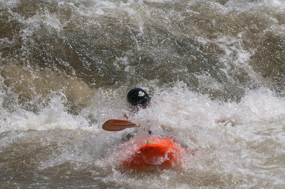 Person rafting in whitewater on the Upper Youghageny River near Friendsville MD
