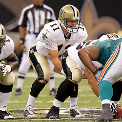 2009 September 03: New Orleans Saints quarterback Mark Brunell (11) under center during a preseason game between the Miami Dolphins and the New Orleans Saints at the Louisiana Superdome in New Orleans, Louisiana.