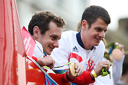 © Licensed to London News Pictures. 28/09/2016. Leeds, UK. Alistair and Jonathan Brownlee atop an open top bus with their medals at the Olympic and Paralympic parade in Leeds. Yorkshire's Olympic and Paralympic stars receive a heroes' welcome during an open top bus parade in Leeds, West Yorkshire. . Photo credit : Ian Hinchliffe/LNP