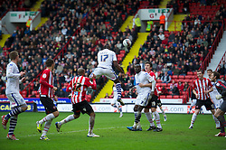 SHEFFIELD, ENGLAND - Saturday, March 17, 2012: Tranmere Rovers' Lucas Akins scores the equalising goal past Sheffield United's goalkeeper Steve Simonsen to level the scores 1-1 during the Football League One match at Bramall Lane. (Pic by David Rawcliffe/Propaganda)