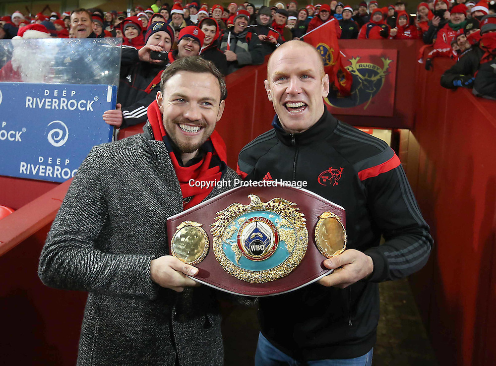 Guinness PRO12, Thomond Park, Limerick 26/12/2014<br /> Munster vs Leinster<br /> World Middle Weight Champion Andy Lee shows his belt off to the Munster fans at Halftime with Munster&rsquo;s Paul O'Connell<br /> Mandatory Credit &copy;INPHO/Billy Stickland