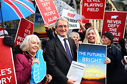 © Licensed to London News Pictures. 20/12/2019. London, UK. Owen Patterson and Andrea Jenkyns join Brexit supporters outside parliament after MPs voted to pass the Withdrawal Agreement Bill. Photo credit: Rob Pinney/LNP
