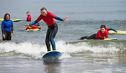 © Licensed to London News Pictures. 19/06/2013<br /> <br /> Saltburn Beach, Cleveland, England, UK<br /> <br /> Students at Saltburn Surf School practice on small waves as they enjoy the beach at Saltburn by the Sea in Cleveland on what could be the hottest day of the year so far.<br /> <br /> Photo credit : Ian Forsyth/LNP