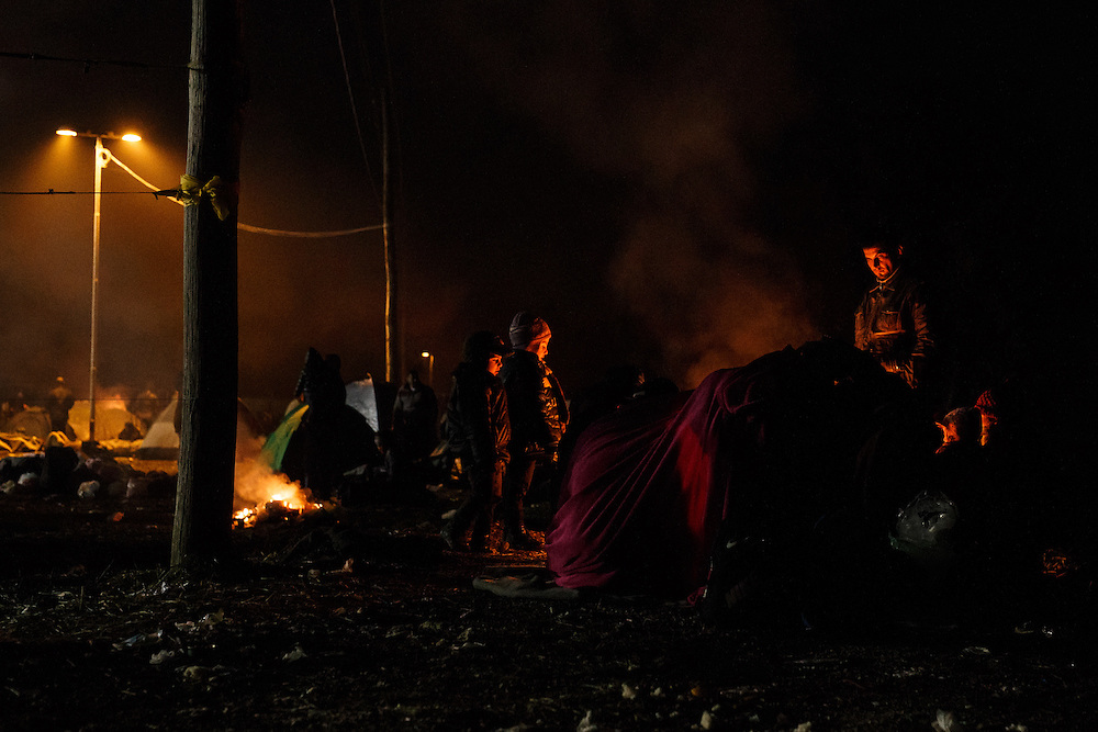 26.10.2015, refugees on the waiting point after crossing border over the bridge between Slovenia in Croatia and walking through no man's land to the open air center on the fields where they must wait for the room in the reception centers in Rigonce, Dobova and Brezice.