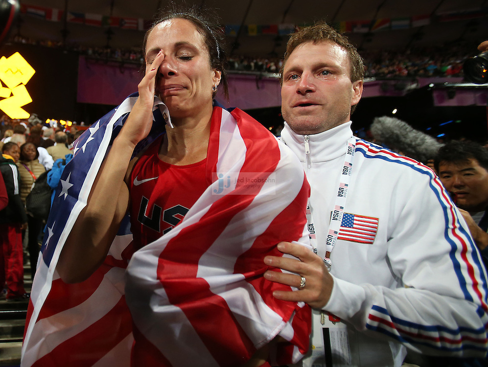 Jennifer Suhr of the USA celebrates with her coach Rick Suhr, after winning the gold medal in pole vault during the track and field at the Olympic Stadium during day 10 of the London Olympic Games in London, England, United Kingdom on August 3, 2012..(Jed Jacobsohn/for The New York Times)..