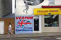 'VERMIN Causes Cancervatives' <br /> New mural by street artist Artful Dodger on a wall in Herne Hill, SE London, UK. Above it a fantastical mural inspired by M. C. Escher by London-based muralist and street artist, Phlegm.<br /> PLEASE CREDIT STREET ARTISTS