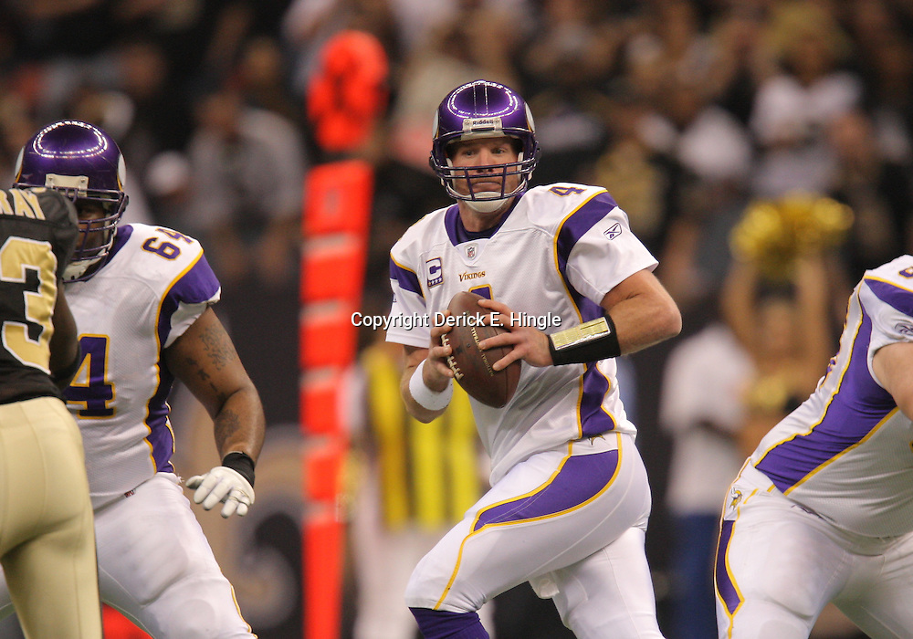 Jan 24, 2010; New Orleans, LA, USA; Minnesota Vikings quarterback Brett Favre (4) drops back to pass during a 31-28 overtime victory by the New Orleans Saints over the Minnesota Vikings in the 2010 NFC Championship game at the Louisiana Superdome. Mandatory Credit: Derick E. Hingle-US PRESSWIRE.
