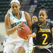 UNCW's Ryan Flowers drives against Towson's Breonn Hughey Sunday January 25, 2015 at Trask Coliseum. (Jason A. Frizzelle)