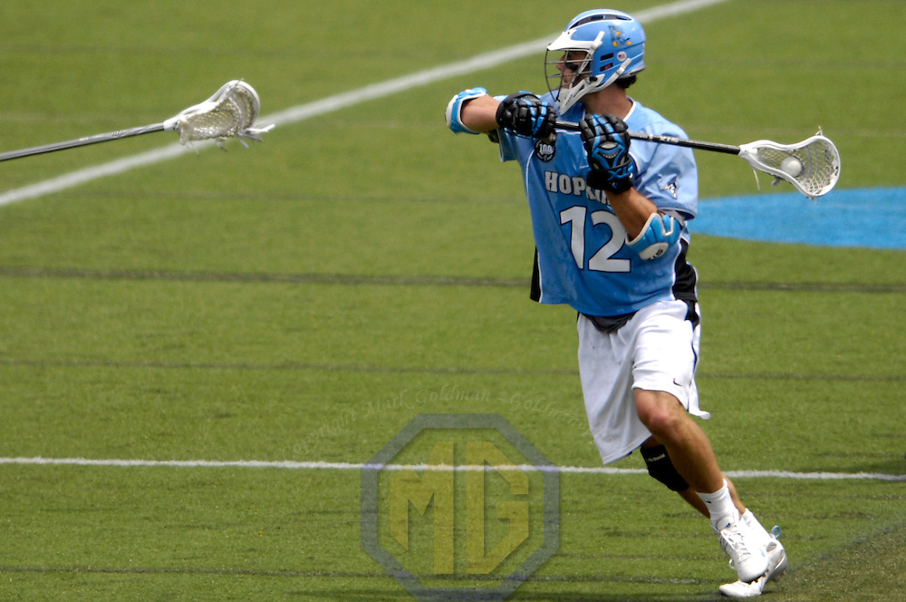 28 May 2007:  Johns Hopkins midfielder Stephen Peyser (12) shoots and  scores a 2nd period goal against the Duke University Blue Devils in the NCAA Division I Lacrosse Championship game.  Byrne led all scorers with 4 goals as the Johns Hopkins Blue Jays defeated the Duke Blue Devils 12-11 to win the NCAA Division I Lacrosse championship at M&T Bank Stadium in Baltimore, Md. .