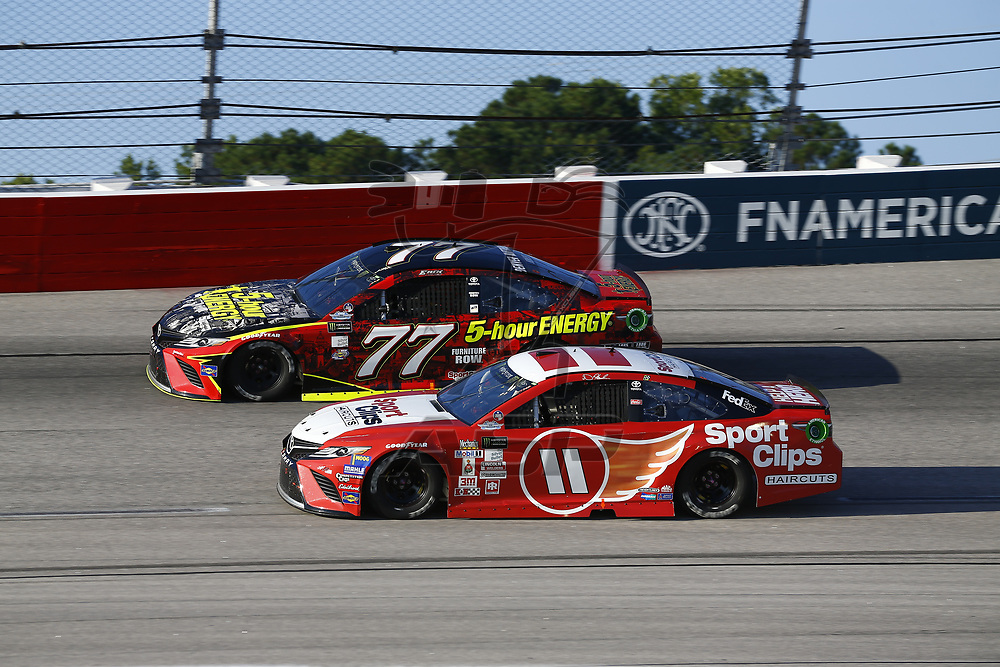 September 03, 2017 - Darlington, South Carolina, USA: Erik Jones (77) and Denny Hamlin (11) battle for position during the Bojangles' Southern 500 at Darlington Raceway in Darlington, South Carolina.