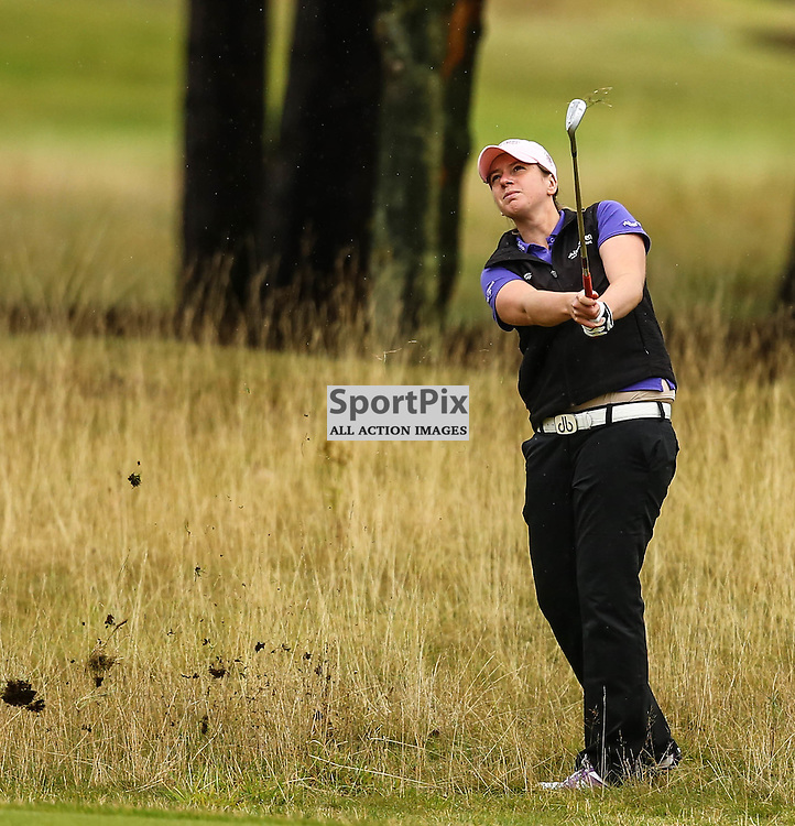 Pamla Prestwell (Scotland) digs her ball out of the rough at the 1st hole. Aberdeen Asset Management Ladies Scottish Open (c) [Neil Bain] | SportPixPix.org.uk