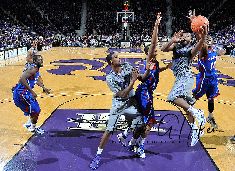 MANHATTAN, KS - FEBRUARY 14:  Guard Jacob Pullen #0 of the Kansas State Wildcats drives in for a score past guard Tyshawn Taylor #10 of the Kansas Jayhawks during the first half on February 14, 2011 at Bramlage Coliseum in Manhattan, Kansas.  Kansas State defeated Kansas 84-68.  (Photo by Peter G. Aiken/Kansas State/Getty Images) *** Local Caption *** Jacob Pullen;Tyshawn Taylor
