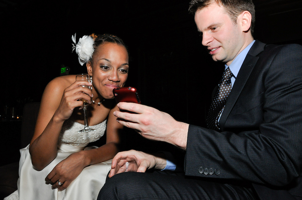 Jamie shows Uzoezi something amusing on his phone, Julia Morgan Ballroom, Merchant's Exchange, San Francisco