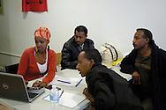 Salem Berhane, Windsor Workers Education Centre volunteer coordinator, meets at WWEC with three members of her Eritrean church to discuss a fundraising project. L to R, Salem Berhane, Tesfay Tsegay, Habtemariam Gazu, and Semere Birhane.